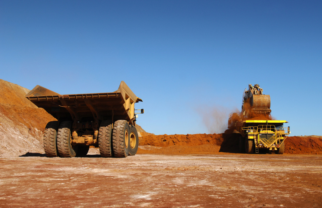 Haul Trucks being loaded with ore.